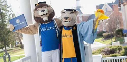 widener mascots dressed in commencement garb with diploma and flowers